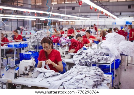 Textile cloth factory working process tailoring workers equipment Royalty-Free Stock Photo #778298764