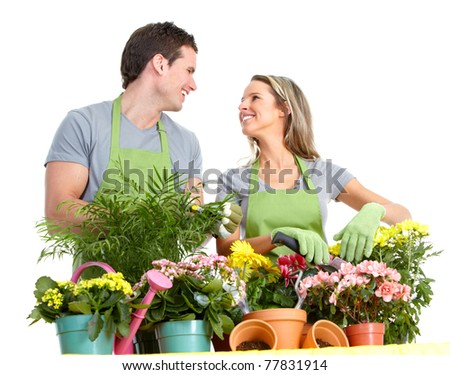 Gardening. People workers with flowers. Isolated over white background #77831914