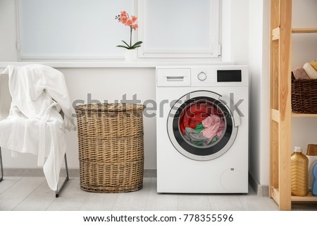 Laundry in washing machine and basket indoors #778355596