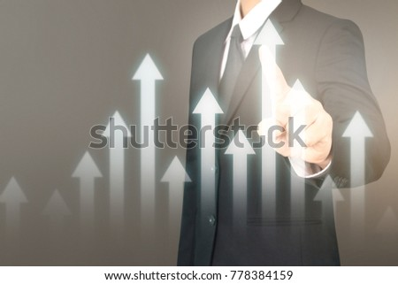 Businessman plan graph growth and increase of chart positive indicators in his business #778384159