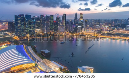Singapore - January 7, 2017: Panorama view of Marina Bay. High view of Singapore Flyer, Marina Bay is one of the most famous tourist attraction in Singapore. #778453285