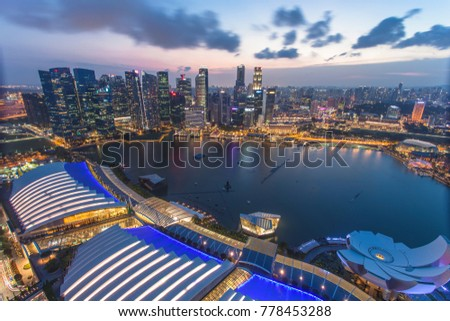 Singapore - January 7, 2017: Panorama view of Marina Bay. High view of Singapore Flyer, Marina Bay is one of the most famous tourist attraction in Singapore. #778453288