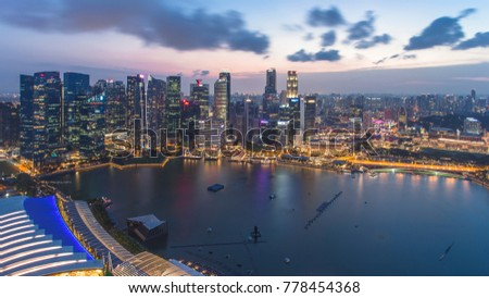 Singapore - January 7, 2017: Panorama view of Marina Bay. High view of Singapore Flyer, Marina Bay is one of the most famous tourist attraction in Singapore. #778454368