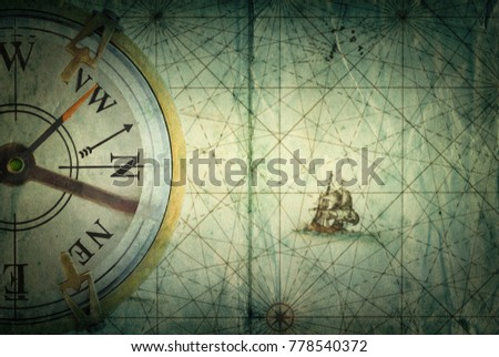 Compass on vintage map. Adventure, travel, stories background.  #778540372