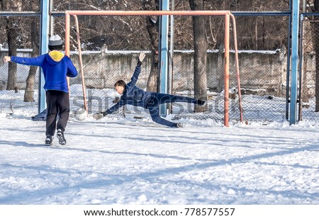 Playing football on the snow in the winter