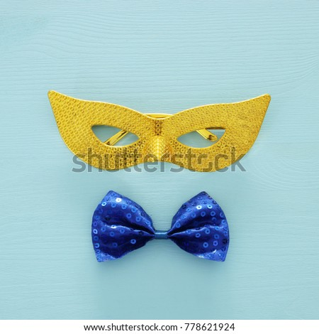 Top view image of masquerade venetian mask background. Flat lay. Purim celebration concept (jewish carnival holiday) #778621924