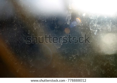 Dirty window with traces of soap, powder close-up #778888012