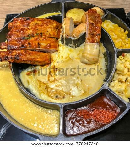 Pork rib with bread , cheese , corn on hot pan #778917340