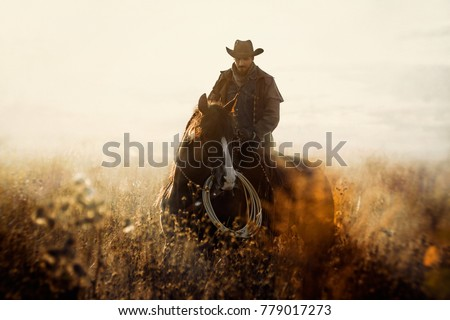 Western cowboy portrait Royalty-Free Stock Photo #779017273