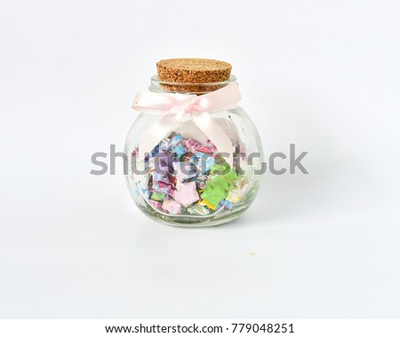 a bottle gift of colorful paper stars  #779048251