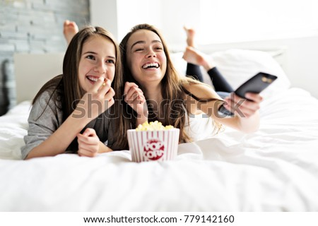 A pajama party, entertainment and junk food concept Royalty-Free Stock Photo #779142160