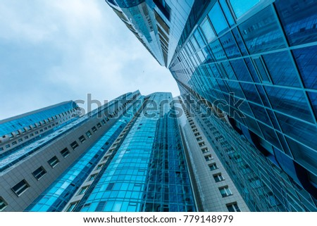 Modern building exterior low angle view with blue sky #779148979
