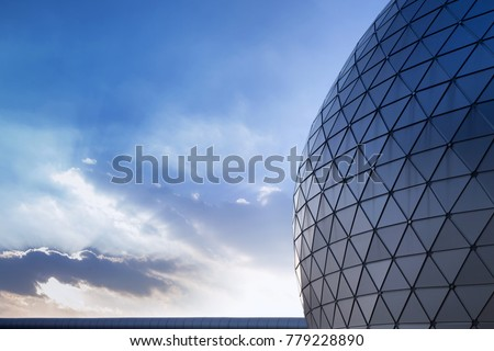 building tunnel and contemporary modern architecture building similar to spaceship exterior design with morning sky background. #779228890