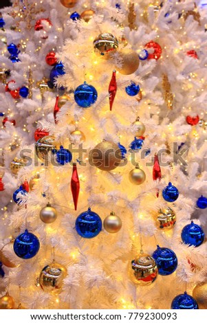 Decorated Christmas on tree blurred, for background. #779230093