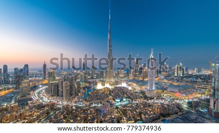 Dubai Downtown day to night transition timelapse with Burj Khalifa and other towers view from the top before new year celebration in Dubai, United Arab Emirates. Lights turning on. #779374936
