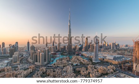Dubai Downtown day to night transition timelapse with Burj Khalifa and other towers view from the top before new year celebration in Dubai, United Arab Emirates. Lights turning on. Zoom in Royalty-Free Stock Photo #779374957
