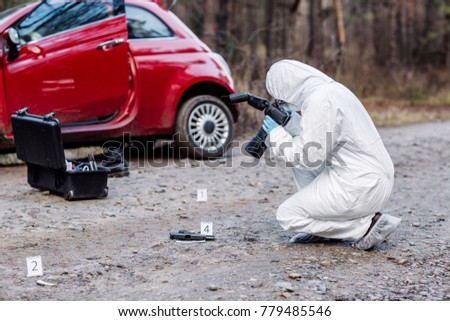 Criminological expert collecting evidence at the crime scene. Law and police concept #779485546