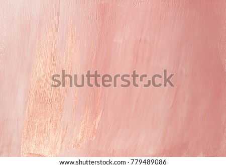 Feminine glamorous dusty pink abstract painted background texture with shiny metallic golden brush streak