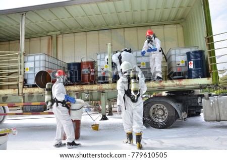 Seremban, Malaysia, 21 December 2017. The special forces Hazmat Fire and Rescue Department of Malaysia, making exercise a chemical spill. #779610505