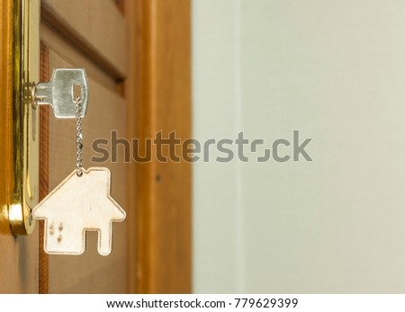 Symbol of the house and stick the key in the keyhole  #779629399