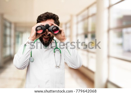 young doctor man with binoculars #779642068