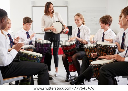 Teenage Students Studying Percussion In Music Class Royalty-Free Stock Photo #779645476
