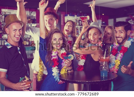 Happy young employees are having fun on the hawaiian party. #779672689