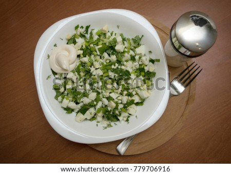 delicious fresh salad with eggs and green sauce #779706916