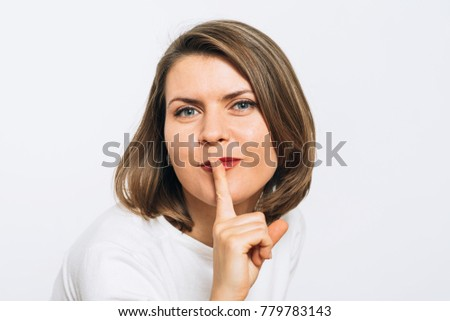 woman put finger on her lips #779783143
