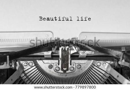 Beautiful life print on a vintage typewriter #779897800