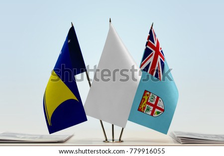 Flags of Tokelau and Fiji with a white flag in the middle #779916055