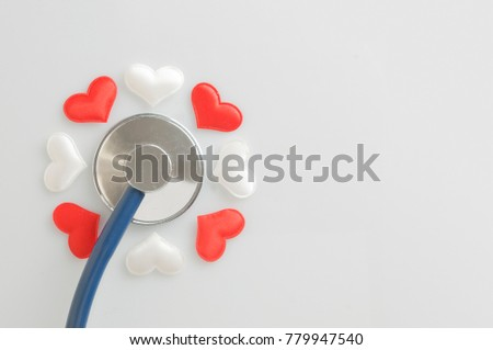 Stethoscope and fabric hearts in flower shape #779947540