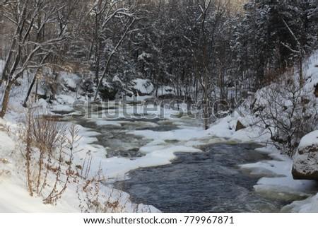 River cascades under the snow #779967871