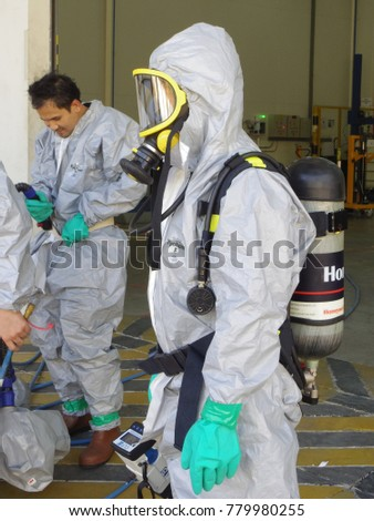Rayong province Thailand , December 22 - 2017 : Chemical spill drill training in factory for chemical emergency and environment protection. #779980255