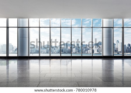 cityscape of hong kong in blue cloud sky from empty office
