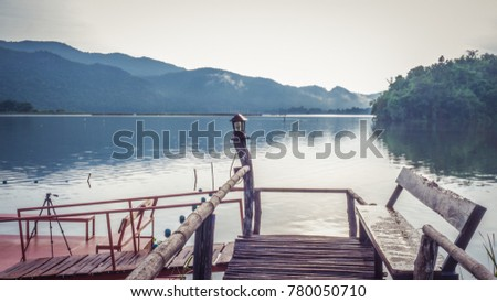 ?Nuture - The lake is surrounded by mountains. #780050710