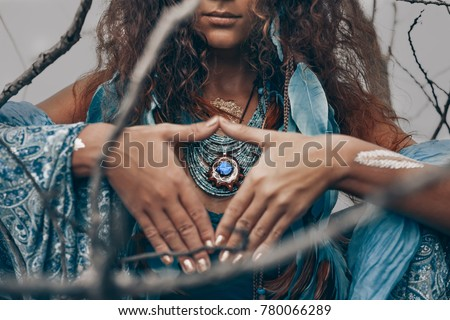 close up of beautiful young woman outdoors. witch craft concept Royalty-Free Stock Photo #780066289