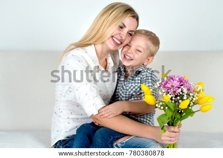Son gives his beloved mother a beautiful bouquet of tulips.The concept of the celebration,women's day. #780380878