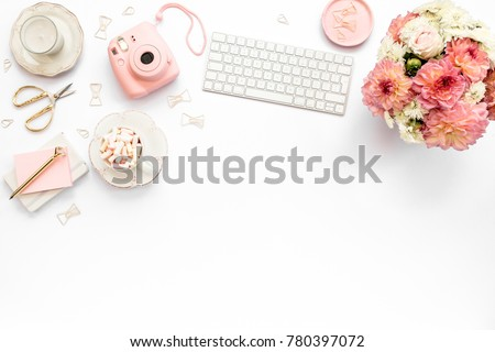 Stylized women's desk, office desk. Workspace with, laptop, bouquet dahlias, roses, clipboard. Women's fashion accessories isolated on white background. Flat lay Top view #780397072