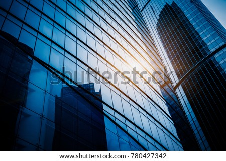 Modern office building against blue sky #780427342