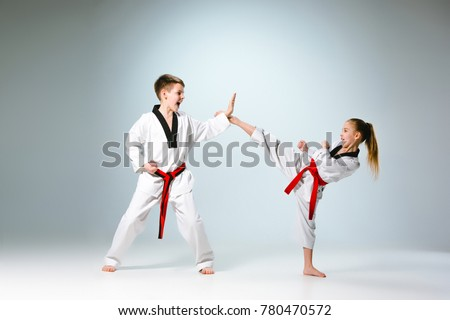 The studio shot of group of kids training karate martial arts #780470572