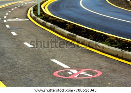 End of walk way sign on the asphalt road surface #780516043