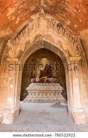 Front view of a statue of sitting Buddha inside an untitled simple temple in Bagan, Myanmar (Burma). #780522922