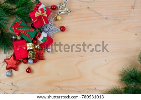 Top view Gift box and Christmas decorations and ornaments on wooden background #780531013