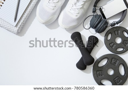 Sports equipment flat lay, unisex, male and female fitness Royalty-Free Stock Photo #780586360