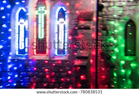 Abstract bokeh blurry background of beautiful colorful lighting during the Christmas and New Year  #780838531