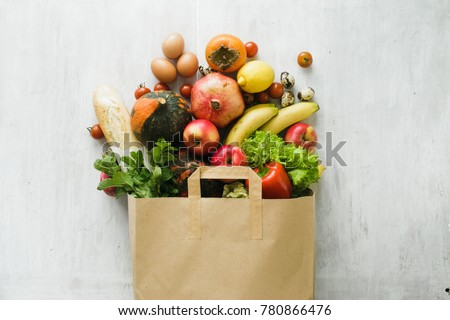 Paper bag of different health food on white wooden background. Top view. Flat lay Royalty-Free Stock Photo #780866476