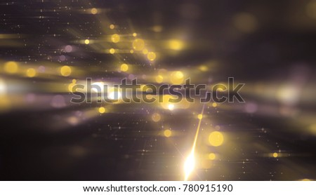 Abstract gold bokeh circles on a black background. Glamour illustration with particles and rays. #780915190