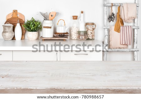 Empty wooden texture table with blurred image of kitchen interior #780988657