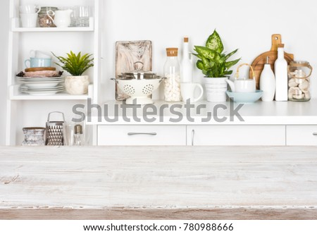 Wooden table over blurred image of kitchen bench and shelf #780988666